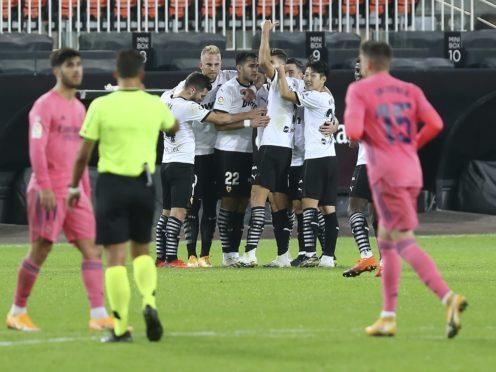 Valencia scored twice in each half to secure a 4-1 win over Real Madrid in LaLiga (Alberto Saiz/AP)