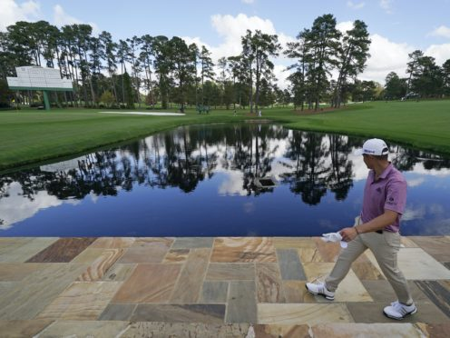 Collin Morikawa walks along the 15th fairway during a practice round for the Masters (AP Photo/Charlie Riedel)