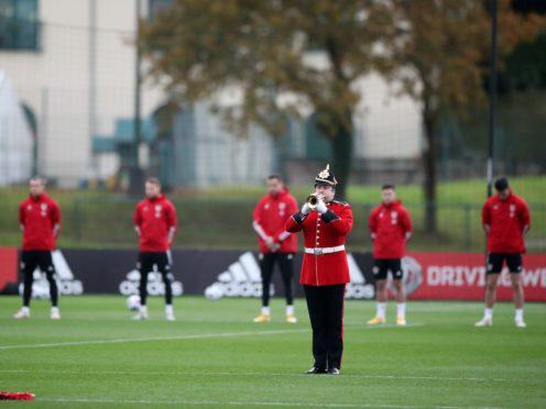 Wales players observe a minute's silence (Nick Potts/PA)