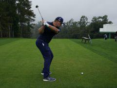 Bryson DeChambeau hits his tee shot on the 10th hole (David J Phillip/AP)