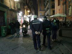 Police officers patrol a street in Naples (Gregorio Borgia/AP)