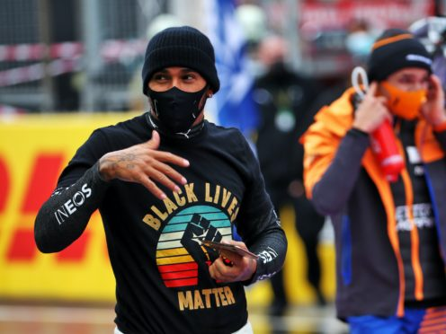 Lewis Hamilton continues to fight against racism (PA)