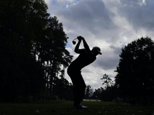 Dustin Johnson tees off on the seventh hole during the final round of the Masters (Charlie Riedel/AP)