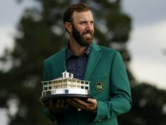 Masters champion Dustin Johnson holds the tournament trophy (Matt Slocum/AP)