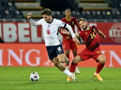 England's Jack Grealish and Belgium's Dries Mertens fight for the ball during the UEFA Nations League League A, Group 2 match at King Power Stadion At Den Dreefts, Leuven, Belgium (DIRK WAEM via Belga/PA)