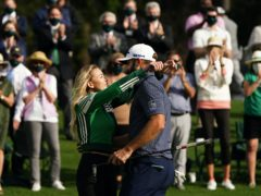 Dustin Johnson celebrated with partner Paulina Gretzky (Matt Slocum/AP)