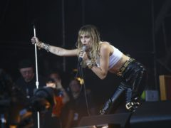 Miley Cyrus and Dua Lipa hit the road in the steamy 1980s-inspired music video for Prisoner (Joel C Ryan/Invision/AP, File)