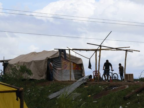People living under precarious conditions make preparations before Hurricane Iota makes landfall in San Manuel Cortes, Honduras (Delmer Martinez/AP)