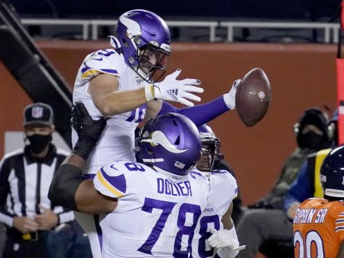 Minnesota Vikings wide receiver Adam Thielen is congratulated by teammate Dakota Dozier (78) after catching a touchdown pass during the second half of an NFL football game against the Chicago Bears (Charles Rex Arbogast/AP)