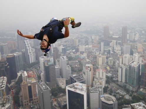 Base jumper Vince Reffet leaps from the 300-metre Open Deck of Malaysia's landmark Kuala Lumpur Tower in 2013 (Vincent Thian/AP)