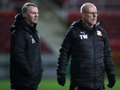 It was a nightmare start for John Sheridan, left, and his assistant Tommy Wright (Nick Potts/PA)