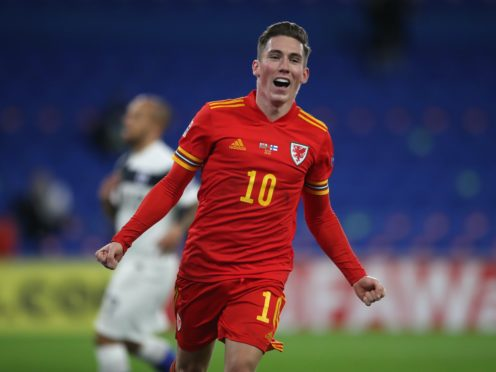 Harry Wilson celebrates after scoring Wales' opening goal against Finland (Nick Potts/PA)