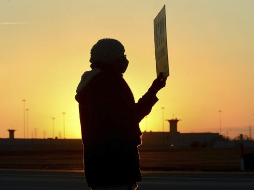 A protester outside Federal Correctional Complex in Terre Haute, Indiana (AP)