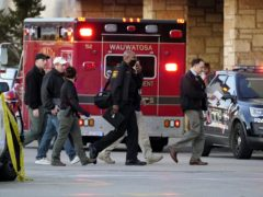 Police officials walk to the Mayfair Mall on Friday, November 20 after multiple people were shot (Nam Y Huh/AP)