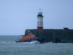 The RNLI severn class Lifeboat head to Newhaven harbour after searching for the missing two fishermen who went missing near Seaford (Steve Parsons/PA)
