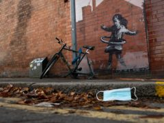 An artwork painted by Banksy on the side of a property in Nottingham (Jacob King/PA)