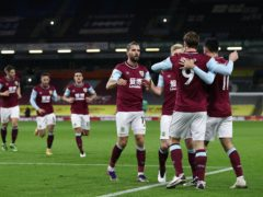 Burnley's Chris Wood (9) celebrates with his team-mates (Jan Kruger/PA)