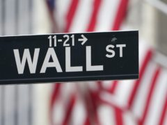 A street sign is displayed at the New York Stock Exchange in New York, Monday, Nov. 23, 2020. Stocks are mostly lower as Wall Street heads into the Thanksgiving holiday. The S&P 500 index slipped 0.4% in the early going Wednesday, but it's still holding on to a gain of almost 11% for the month. (AP Photo/Seth Wenig)