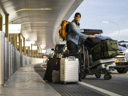 Travellrs arrive at Terminal C at LaGuardia Airport, New York (John Minchillo/AP)