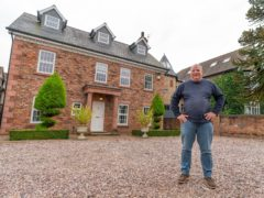 Ian Garrick outside the £1m house in Cheadle Hulme, Cheshire, that he won for £10 as part of a charity draw in aid of Teenage Cancer Trust (Omaze/PA)