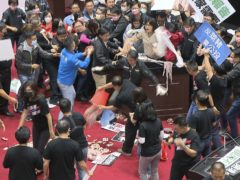 Politicians fight during a parliament session in Taipei, Taiwan (FTV via AP)