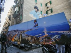 There have been many tributes to Diego Maradona in Naples, where he twice won the Serie A title (Alessandra Tarantino/AP)