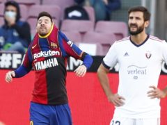 Barcelona's Lionel Messi remembered Diego Maradona after scoring against Osasuna (Joan Monfort/AP)