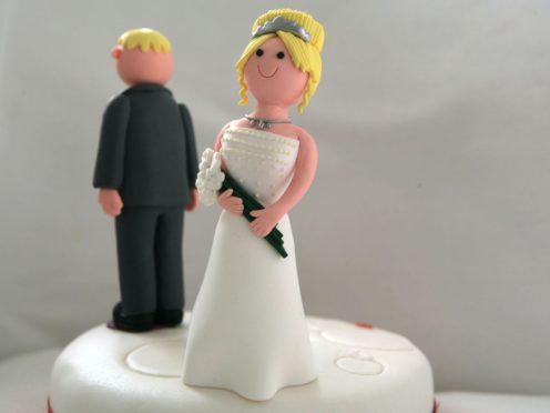Bride and groom on a wedding cake (PA)