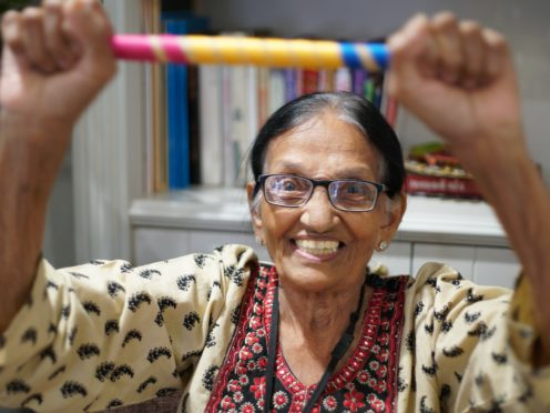 A care home resident in an Oomph! exercise class (PA)