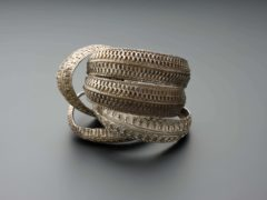 Four annular silver 'ribbon bracelet' arm-rings from the Viking-age Galloway Hoard (National Museums Scotland/PA)