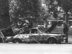 Police forensic officers working on the remains of the IRA car which housed the Hyde Park car bomb (PA)