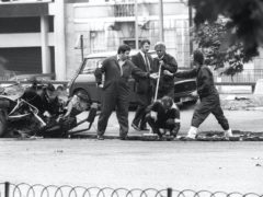Police forensic officers working on the remains of the car which housed the Hyde Park car bomb in 1982 (PA)