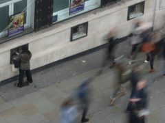 People walking past ATMs before the coronavirus pandemic. Three in four people think Covid-19 will affect their use of cash in the coming months, according to ATM network Link (Anthony Devlin/PA Wire)