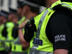 The Scottish Police Authority reported an overspend of £26.8m last year (Andrew Milligan/PA)