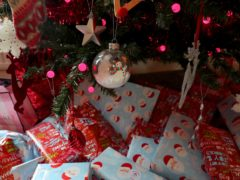 Presents wrapped and under a Christmas tree. Nearly seven in 10 shoppers had problems with Christmas deliveries last year, according to a survey from Which? (Peter Byrne/PA)