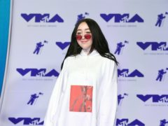 Singer Noah Cyrus has apologised after using an 'offensive' term while defending Harry Styles (PA)
