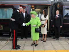 The Queen and the Duchess of Sussex arriving by Royal Train at Runcorn Station to carry out engagements in Cheshire.in 2018