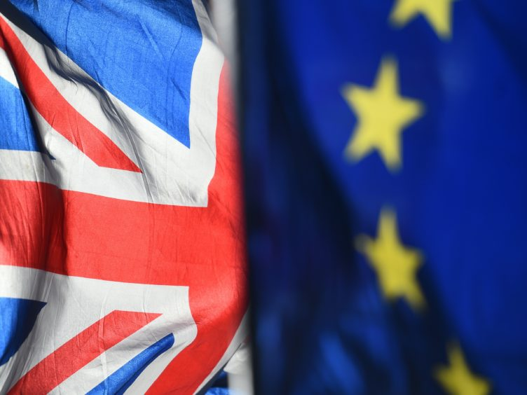 Union and European Union flags (Kirsty O'Connor/PA)