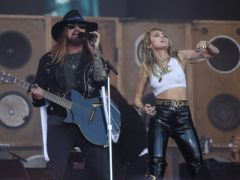 Miley Cyrus and her father Billy Ray Cyrus (Yui Mok/PA)