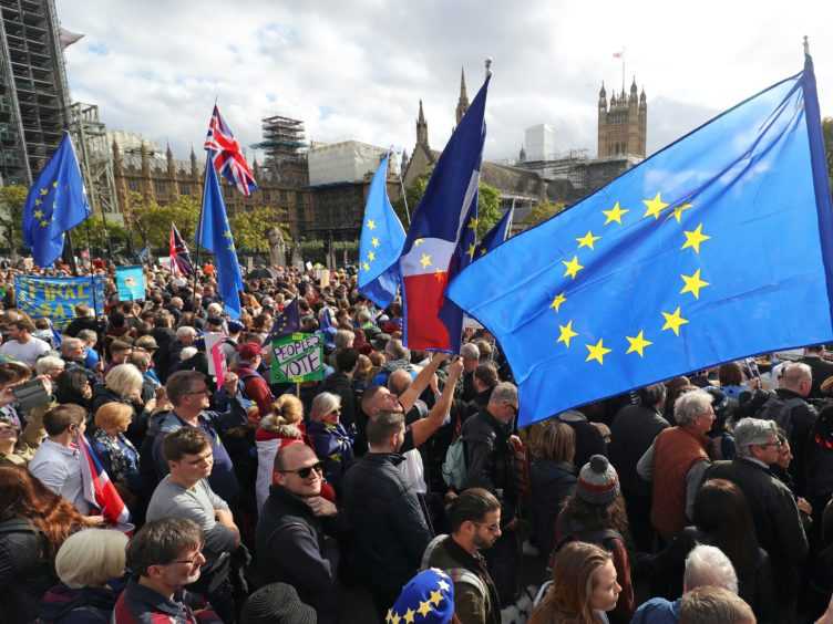 Anti-Brexit protesters demonstrate in Parliament Square (Andrew Matthews/PA)