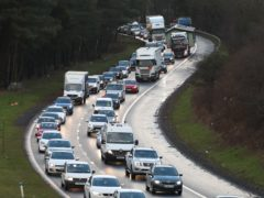 The Scottish Government is aiming to cut car journeys significantly by 2030 (Andrew Milligan/PA)