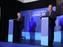 Health minister Robin Swann (left) and finance minister Conor Murphy during a Coronavirus media briefing (Kelvin Boyes/Press Eye/PA)