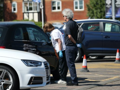 Customers at Motorpoint Chingford car dealer in north London, as car showrooms reopen to the public following the introduction of measures to bring England out of lockdown.