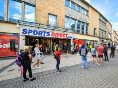 Queues outside Sports Direct in Bristol (Ben Birchall/PA)