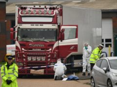 Police and forensic officers at the scene in Essex, after the 39 bodies were found (Stefan Rousseau/PA)
