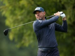 Lee Westwood is battling a back injury as he tries to win a third Race to Dubai title (David Davies/PA)