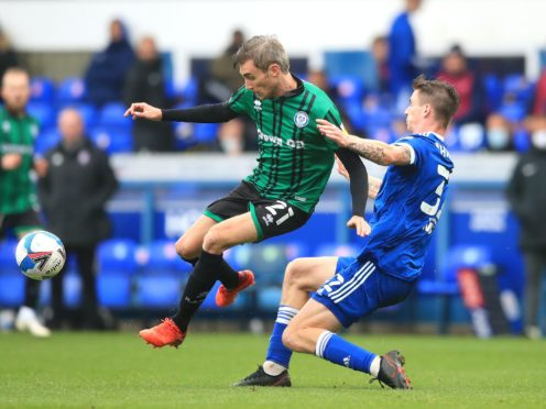 Matty Lund is suspended for the visit of Gillingham (Adam Davy/PA)
