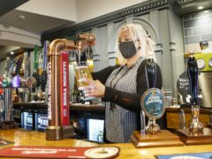 The Society of Independent Brewers has called on the Government to give pubs and breweries the business rates cash being returned by Tesco (Danny Lawson/PA)