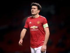 Harry Maguire is ready to lead United into battle in Germany (Martin Rickett/PA)