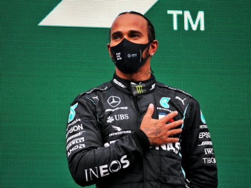 Lewis Hamilton hopes he will be able to race in Abu Dhabi (PA)